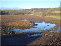 SO7334 : Ploughed field and dung heap at Oak by Trevor Rickard