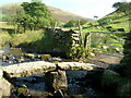 NY6927 : Ancient clapper bridge over Great Rundale Beck by glyn swain