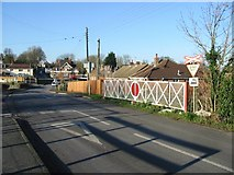 TR2849 : Railway crossing Shooters Hill at Eythorne by Nick Smith