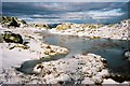 NY2406 : Frozen pool of water near Bowfell summit by Peter S