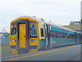 SH3735 : The 15.32 Birmingham New Street Arriva Wales train about to depart from Pwllheli Station by Eric Jones