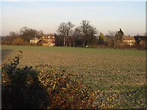 TR3156 : View across the field to Grove Manor Farm by Nick Smith