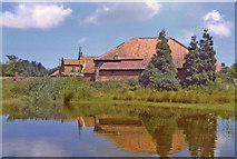 TG0934 : Pond, Edgefield Green, Norfolk by Christine Matthews