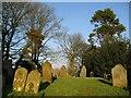 NY1133 : Old gravestones in St Bridget's Churchyard by Alison Rawson