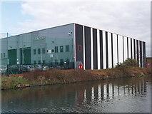 TQ2282 : Car service building in Hythe Road by David Hawgood