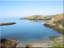 SH4793 : Placid Porth Eilian with the Lynas Point lighthouse in the background by Eric Jones