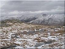 NN0747 : Frozen bogs near the summit of An Grianan by Richard Webb