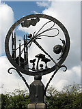 TG1022 : Booton village sign - detail by Evelyn Simak