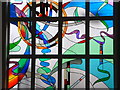 SO2758 : Stained glass window in the chapel at Dunfield House by A Holmes