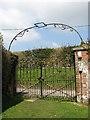 TG0436 : Churchyard gate by Evelyn Simak