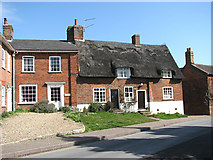 TG1022 : Attractive thatched cottage on Church Hill by Evelyn Simak