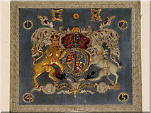 TG1022 : St Mary's church - royal arms by Evelyn Simak
