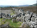 NN9560 : Dry stone wall junction by Russel Wills