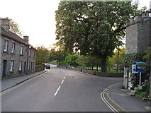 SK2572 : Baslow - Village Green (bus stop area) by Alan Heardman