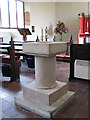 TG5011 : St Edmund's church - baptismal font by Evelyn Simak