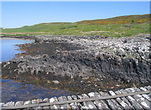 NR6880 : Derelict jetty and rocks at Keills by E Gammie