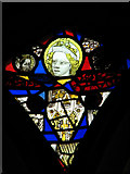 TM0099 : St Peter's church - medieval stained glass by Evelyn Simak