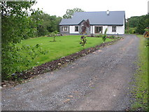 G7877 : Residence along the N56 road west of Knocknahorna by C Michael Hogan