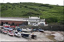 SX0080 : St Endellion: Port Gaverne cellars by Martin Bodman
