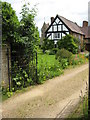 SO9842 : Half-timbered cottage, Bricklehampton by Philip Halling