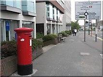SZ0991 : Bournemouth: postbox № BH8 32, Holdenhurst Road by Chris Downer