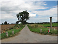 TG2225 : This looks like a private road by Evelyn Simak