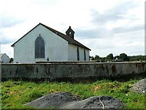 N6124 : Cemetery wall and church by James Allan