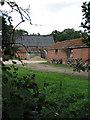 TG3109 : Red-brick farm barns by Evelyn Simak