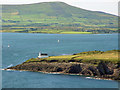 V4598 : Cliffs and lighthouse before Dingle Bay by Peter Church