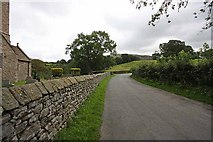 SD6382 : Road past St Bartholomew, Barbon, Cumbria by John Salmon