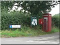 SU0206 : Chalbury Common: postbox № BH21 31, phone box, noticeboard by Chris Downer