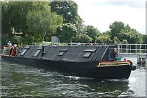 TQ0469 : Narrowboat leaving Penton Hook Lock by Graham Horn
