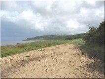 SH5580 : View east along the beach at Llanddona by Eric Jones