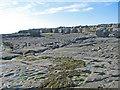 R0597 : Limestone pavement beachfront north of Doolin pier by C Michael Hogan