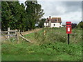 SU0113 : Monkton Up Wimborne: postbox № BH21 111 and Manor Farm by Chris Downer