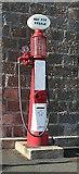 NJ8631 : Old Petrol Pump by Anne Burgess
