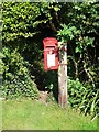 ST8108 : Turnworth: postbox № DT11 48, Home Farm by Chris Downer