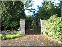 NH6037 : Gates to Aldourie Castle by Sarah McGuire