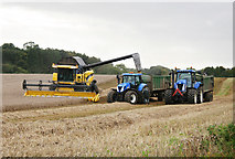 NZ0261 : Combine and tractors next to the A695 by Helen Wilkinson